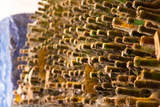 Tuscany Wine Trail - Old wine bottles in the cellar